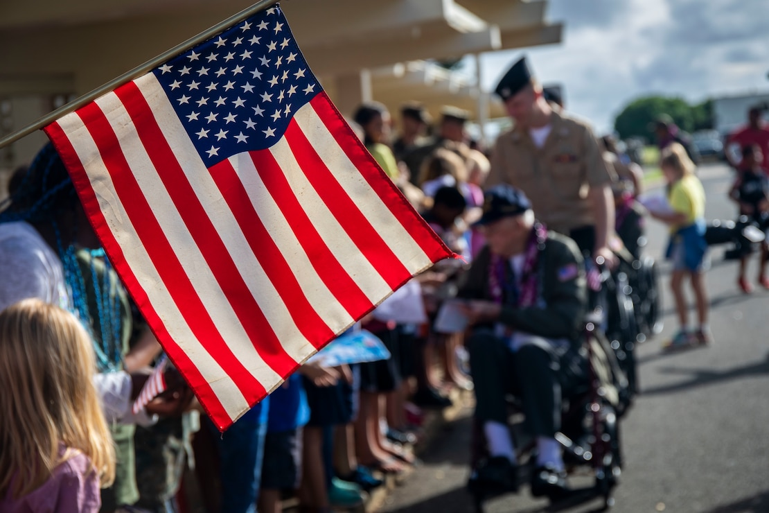 An American flag is displayed during a U.S. Navy veterans visit to Marine Corps Base Hawaii, Dec. 5, 2019. The Best Defense Foundation returned 6 WWII Pearl Harbor and Naval Air Station Kaneohe Bay survivors to Hawaii for the 78th Commemoration of Pearl Harbor and Naval Air Station Kaneohe Bay which is now MCBH. The heroes returned were Jack Holder US NAVY - Naval Air Station, Kaneohe Bay; Tom Foreman US Navy - USS Cushing; Ira Schab US Navy - USS Dobbin; Stuart Hedley US Navy - USS West Virginia; Donald Long US Navy - Naval Air Station, Kaneohe Bay; and Chuck Kohler US Navy - USS Hornet.
