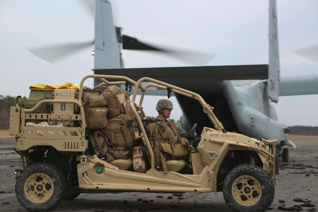 Marines unload a Utility Task Vehicle from an MV-22B Osprey on Camp Lejeune, North Carolina, Feb. 19, 2019. The UTV increased mobility and load bearing capacity for the Marines during an airfield occupation exercise. Program Executive Officer Land System's Light Tactical Vehicle program office is currently implementing several upgrades—including upgraded tires, clutch improvement kit and floorboard protection—to UTVs across the fleet. (U.S. Marine Corps photo by Lance Cpl. Camila Melendez)