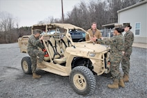Jason Engstrom, center, a Utility Task Vehicle engineer with Program Executive Officer Land Systems, reviews several of the vehicles upgrades with Marines at the Transportation Demonstration Support Area aboard Marine Corps Base Quantico, Virginia, Dec. 4, 2019. PEO Land System's Light Tactical Vehicle program office is currently implementing several upgrades—including an environmental protection cover, upgraded tires and clutch improvement kit—to UTVs across the fleet. (U.S. Marine Corps photo by Ashley Calingo)