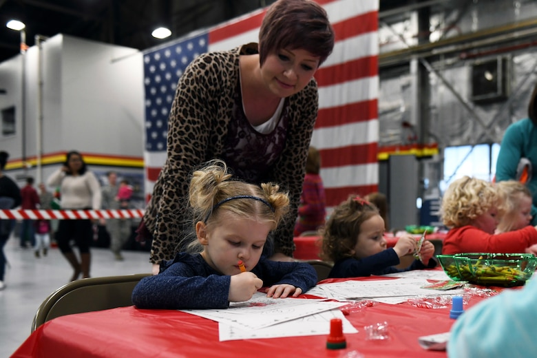 Candi Kimber, spouse of a 419th Fighter Wing reservist, watches over her daughter, Cambrie, as she colors at the Children's Christmas Party Dec. 8 at Hill Air Force Base, Utah