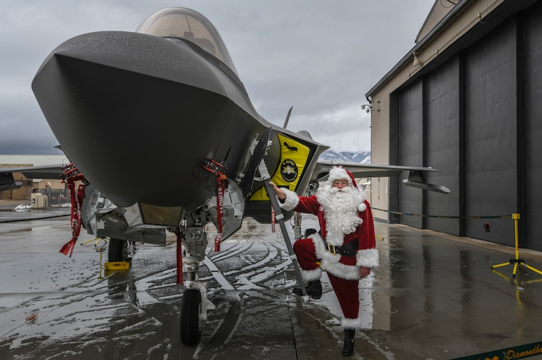 Santa poses for a picture in front of an F-35 Lightning II before visiting members of the 419th Fighter Wing Dec. 8 at Hill Air Force Base, Utah