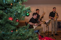 Members of the 9th Army Band from Joint Base Elmendorf-Richardson, Alaska, perform during Eielson's Winter Festival at the Yukon Club on Eielson Air Force Base, Alaska, Dec. 6, 2019. The band provided live holiday music for the Airmen and families in attendance. (U.S. Air Force photo by Airman 1st Class Aaron Larue Guerrisky)