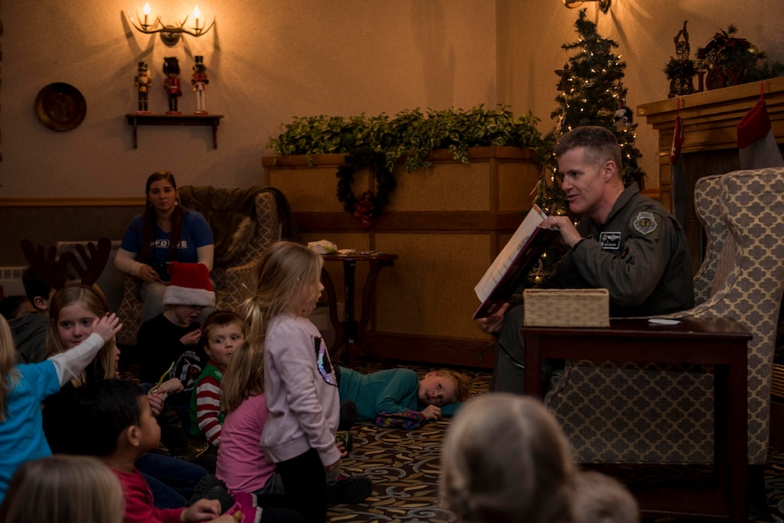 "U.S. Air Force Col. Benjamin Bishop, 354th Fighter Wing commander, reads during Eielson's Winter Festival at the Yukon Club on Eielson Air Force Base, Alaska, Dec. 6, 2019. The Winter Festival concluded with Bishop reading ""The Night Before Christmas"" to children in attendance. (U.S. Air Force photo by Airman 1st Class Aaron Larue Guerrisky)"