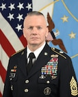 U.S. Army Command Sgt. Maj. John Wayne Troxell, senior enlisted advisor to the chairman of the Joint Chiefs of Staff, poses for his official portrait with the new SEAC rank insignia in the Army portrait studio at the Pentagon in Arlington, Va., Dec. 9, 2019.