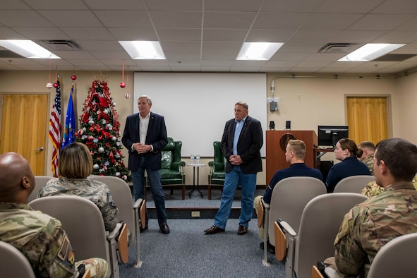 Retired Chief Master Sgts. of the Air Force Eric W. Benken and Jim Finch speak with enlisted members at Cannon Air Force Base, N.M., Dec. 5, 2019. The 12th and 13th Chief Master Sgts. of the Air Force visited Cannon to share their stories with Air Commandos. (U.S. Air Force photo Senior Airman Vernon R. Walter)
