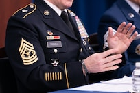 """Army Command Sgt. Maj. John Wayne Troxell, Senior Enlisted Advisor to the chairman of the Joint Chiefs of Staff, speaks as he prepares to depart the position during a press briefing in the Pentagon Press Briefing Room, Washington, D.C., Dec. 9, 2019. Troxell conduct a Change of Responsibility and hand the duties off to Air Force Chief Master Sgt. Ramon """"CZ"""" Colon-Lopez, incoming Senior Enlisted Advisor to the Chairman of the Joint Chiefs of Staff."""