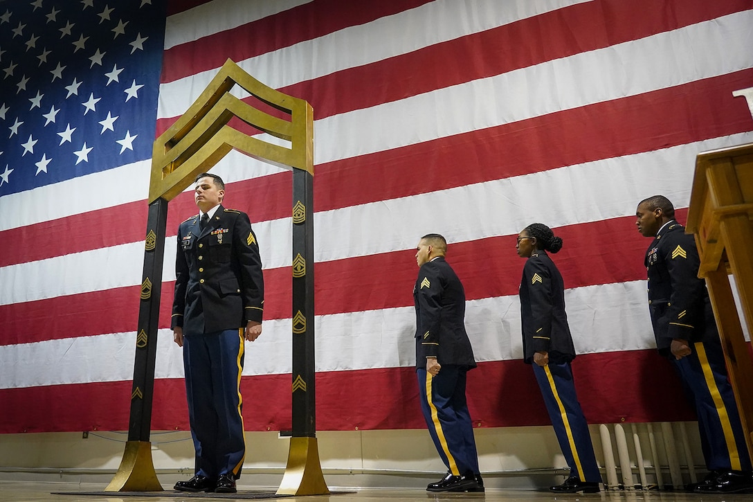 Army Sgt. Corey Ford, assigned to the 95th Chemical Company, 17th Combat Sustainment Support Battalion, U.S. Army Alaska, participates in a Noncommissioned Officer induction ceremony at the Alaska Army National Guard armory on Joint Base Elmendorf-Richardson, Alaska, Dec. 6, 2019, as he makes the career transition into junior leader, and is promoted to the rank of sergeant. When Army Soldiers are promoted to the noncommissioned officer ranks they become the first level of authority in their Soldiers' chains of command, and are responsible for their charges' health, welfare, training and discipline.