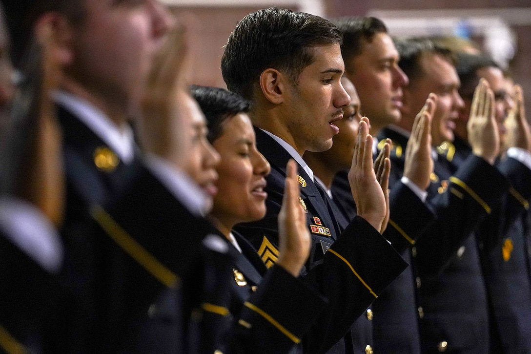 Army Sgt. Franco Leon, assigned to the 539th Composite Truck Company (Light), 17th Combat Sustainment Support Battalion, U.S. Army Alaska, recites the noncommissioned officer creed during an NCO induction ceremony at the Alaska Army National Guard armory on Joint Base Elmendorf-Richardson, Alaska, Dec. 6, 2019, as he and his fellow Soldiers make the career transition into junior leaders, and are promoted to the rank of sergeant. When Army Soldiers are promoted to the noncommissioned officer ranks they become the first level of authority in their Soldiers' chains of command, and are responsible for their charges' health, welfare, training and discipline.