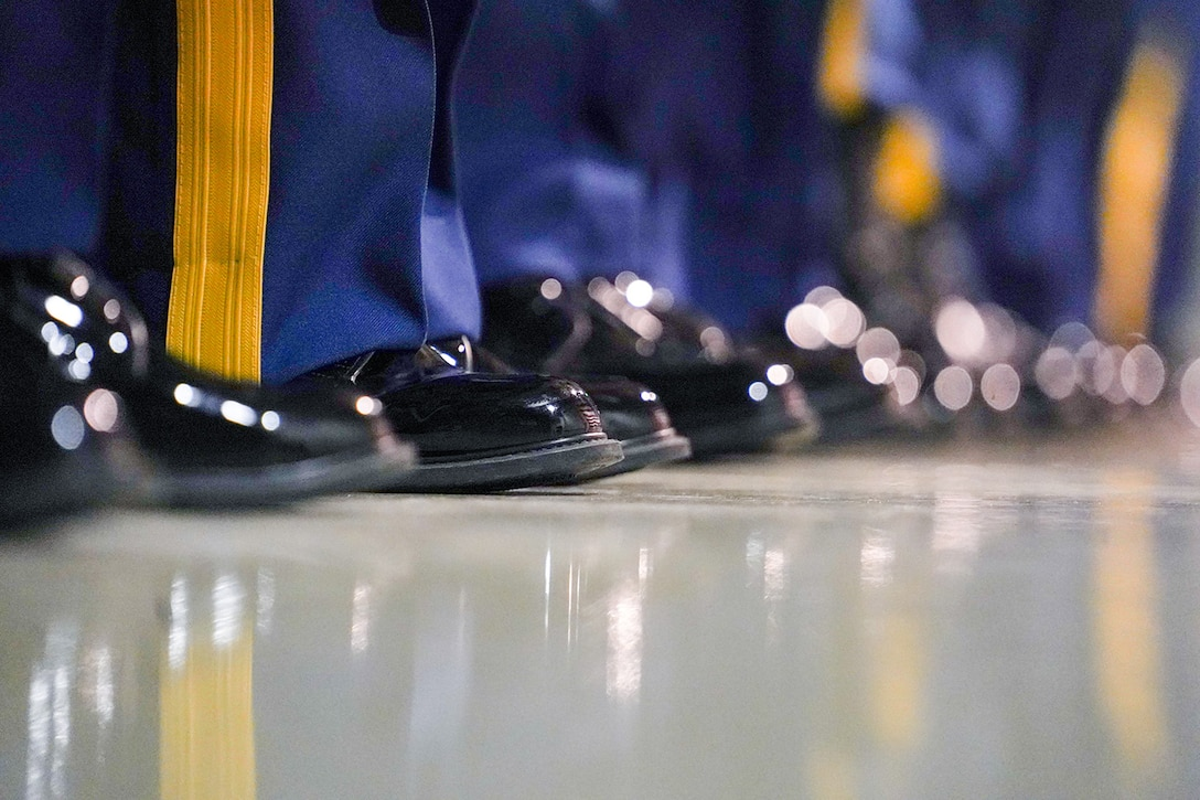 Soldiers assigned to U.S. Army Alaska stand at the position of attention as they participate in a Noncommissioned Officer induction ceremony at the Alaska Army National Guard armory on Joint Base Elmendorf-Richardson, Alaska, Dec. 6, 2019. When Army Soldiers are promoted to the noncommissioned officer ranks they become the first level of authority in their Soldiers' chains of command, and are responsible for their charges' health, welfare, training and discipline.