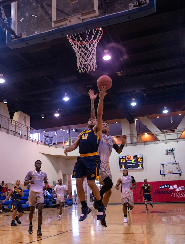 Naval Base San Diego Tritons basketball player goes for a layup