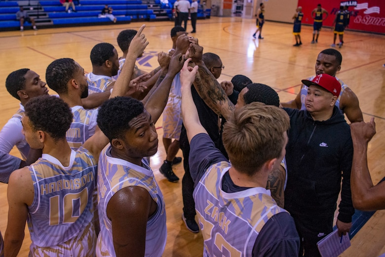 Nellis Lightning team put hands in for huddle