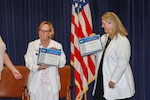 """Certified Breast Care Nurse and Breast Health Navigator Marguerite """"Meg"""" Shrader from Chesapeake Regional Breast Center (left), and Lactation Consultant Karla Johnson from Naval Medical Center Portsmouth (right) were awarded with a certificate of appreciation for their education efforts for the NNSY workforce by the Federal Women's Program."""