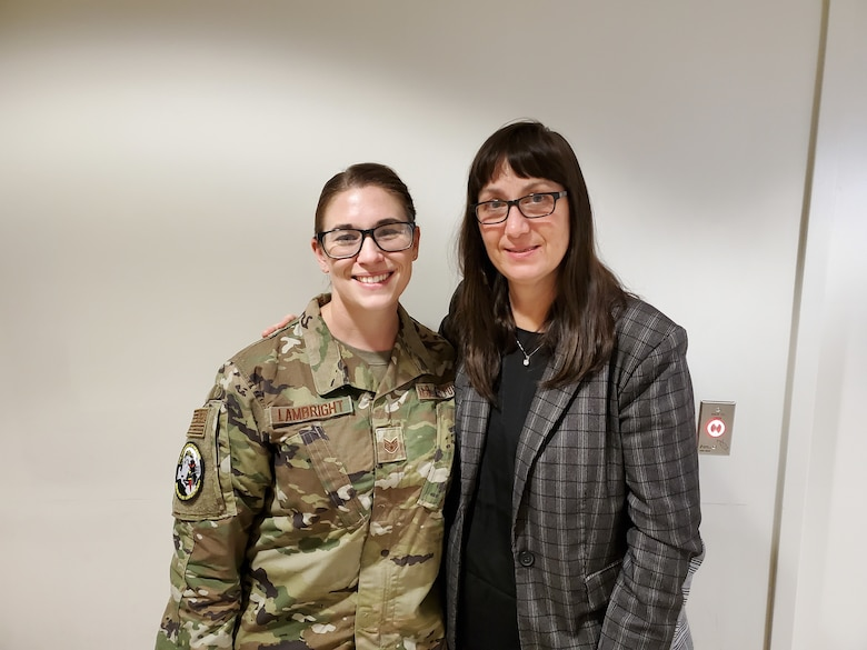Staff Sgt. Chaya Lambright (left), a medical laboratory technician with the 711 Human Performance Wing, was recently recognized for assisting Bridget Kleismit (right) during a medical emergency at the Wright Field Fitness Center on Wright-Patterson Air Force Base.