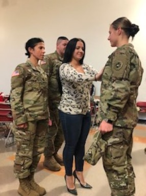 The Army Non-commissioned Officer Corps gained another leader when Sgt. Dana Valenia, a 68C, Licensed Practical Nurse, was promoted in front of Family and fellow 865th Combat Support Hospital Soldiers, Dec. 8, 2019.