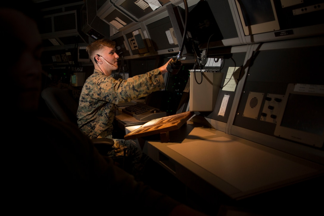 Cpl. Jacob Lenling sits in the radar room of the air traffic control tower aboard Marine Corps Air Station Beaufort, Dec. 4. Lenling is an air traffic controller with Headquarters and Headquarters Squadron. In honor of International Volunteer Day, Lenling is being recognized for having more than 431 volunteer hours.