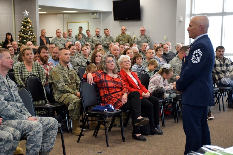 Former Command Chief Master (CCM) Sgt. Timothy E. Cochran speaks during his retirement ceremony held in the Dining Facility at the 132d Wing in Des Moines, Iowa on Saturday, December 7, 2019.  Cochran is the 6th CCM of Iowa; his successor, CCM Thomas (T.J.) Fennell assumed responsibility in November.  (Air National Guard photo by Tech. Sgt. Linda K. Burger/Released)