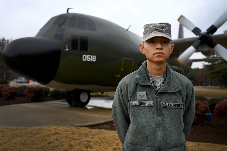 A man stands in front of a plane.