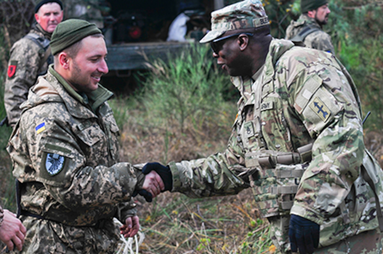 Staff Sgt. Michael Blevins, an adviser with Task Force Juvigny, greets his Armed Forces Ukraine counterparts during battalion training at the Combat Training Center – Yavoriv, Ukraine, Nov 13, 2019.