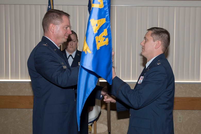 Col. Marty Timko, 167th Operations Group commander, passes the 167th Operations Support Squadron flag to Lt. Col. James Freid-Studlo during the 167 OSS change of command ceremony at the 167th Airlift Wing, Dec. 7, 2019.