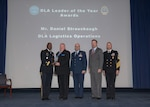Five men pose with leader of the year award during the DLA 52nd Annual Employee Recognition Awards Ceremony Dec. 6.