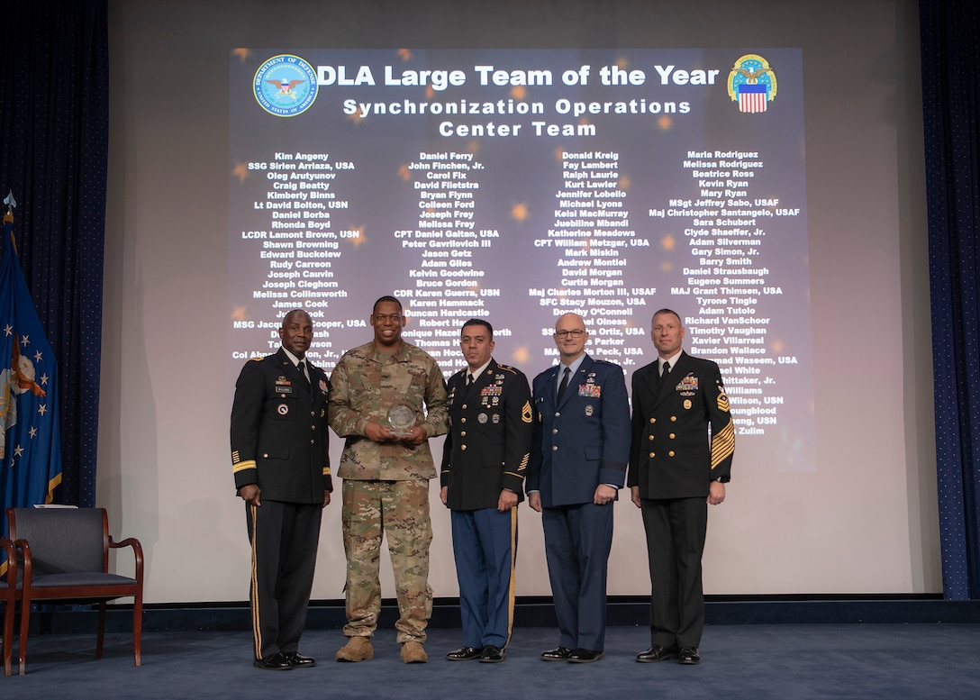 Five men pose with a group award during the Dec. 6 DLA Employee Recognition Awards Ceremony.