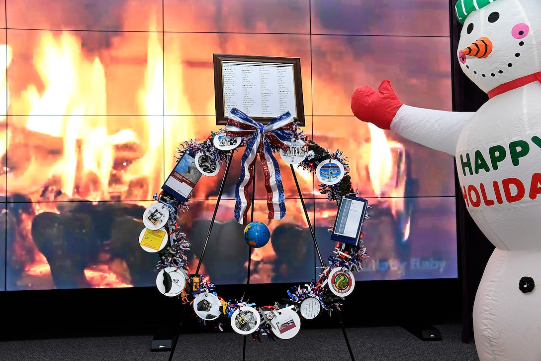 """The Contracting Directorate's entry in the wreath competition features the staff own carol, """"The Twelve Months of the Fiscal Year,"""" as well as clever visuals about contracting."""