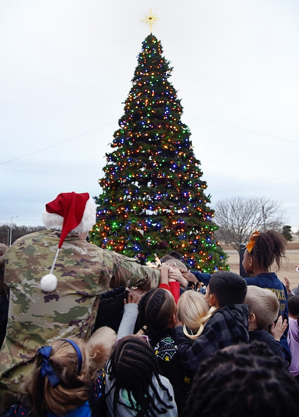 An image of 72nd Air Base Wing Commander Col. Paul Filcek at Tinker's tree lighting and holiday parade.