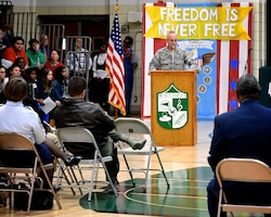As part of community relations outreach, Lt. Col Stan Paregien from the 932nd Airlift Wing's Public Affairs Office, speaks regarding American veterans to Grant Junior High School students November 6, 2019. Later in the week he was joined at Highland Junior Hight School by a 73rd Airlift Squadron pilot and commander, Lt. Col. Brandon Lorton.   A display booth was set up early in the morning and Paregien answered questions for several hours to multiple rotating classes about the Air Force Reserve. He handed out some military gear for students to pass around, along with an American flag, and answered student's questions about what it takes to become an American Airman during an all day event culminating with a final school assembly, then featuring Lt. Col. Lorton as the keynote speaker interacting with local veterans from the community. (Photo submitted)