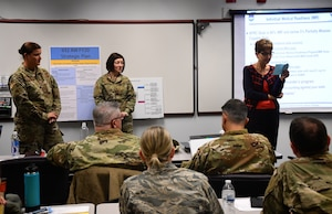 "At right, Stephanie Boehning, 932nd Airlift Wing process improvement manager, speaks to commanders as they learn more about IMR (Individual Medical Readiness).  932nd Airlift Wing commanders received additional briefings and training to help increase their management skills on November 14, 2019, at Scott Air Force Base, Ill.  The 932nd AW is an Air Force Reserve unit flying the C-40C aircraft and is known among reserve units as the ""Gateway Wing"" due to its close proximity to St. Louis and the arch.