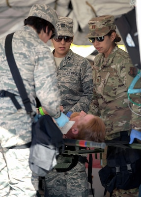 Capt. Gabriela Torres, Capt. Denise Rodriguez and Capt. Araceli Vazquez, all trauma nurses assigned to the 149th Medical Group's Det. 1, simulates providing medical treatment to a role player during the Texas National Guard's 6th CERFP Task Force, which includes the 149th Fatality Search and Recovery Team, participated in a response evaluation exercise Dec. 7, 2019, in Round Rock, Texas.
