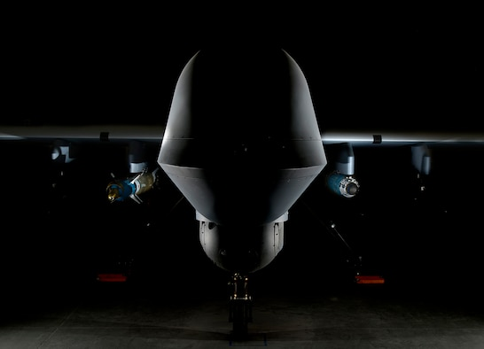 An MQ-9 Reaper is loaded with a GBU-12 laser-guided bomb on the left and a GBU-38 Joint Direct Attack Munition on the right April 13, 2017, at Creech Air Force Base, Nevada. The JDAM is a GPS guided munition which brings added capability to the warfighters, specifically by aircrews being able to employ weapons through inclement weather. The first two GBU-38s employed in training successfully hit their targets May 1, 2017, over the Nevada Test and Training Range. (U.S. Air Force photo by Senior Airman Christian Clausen)