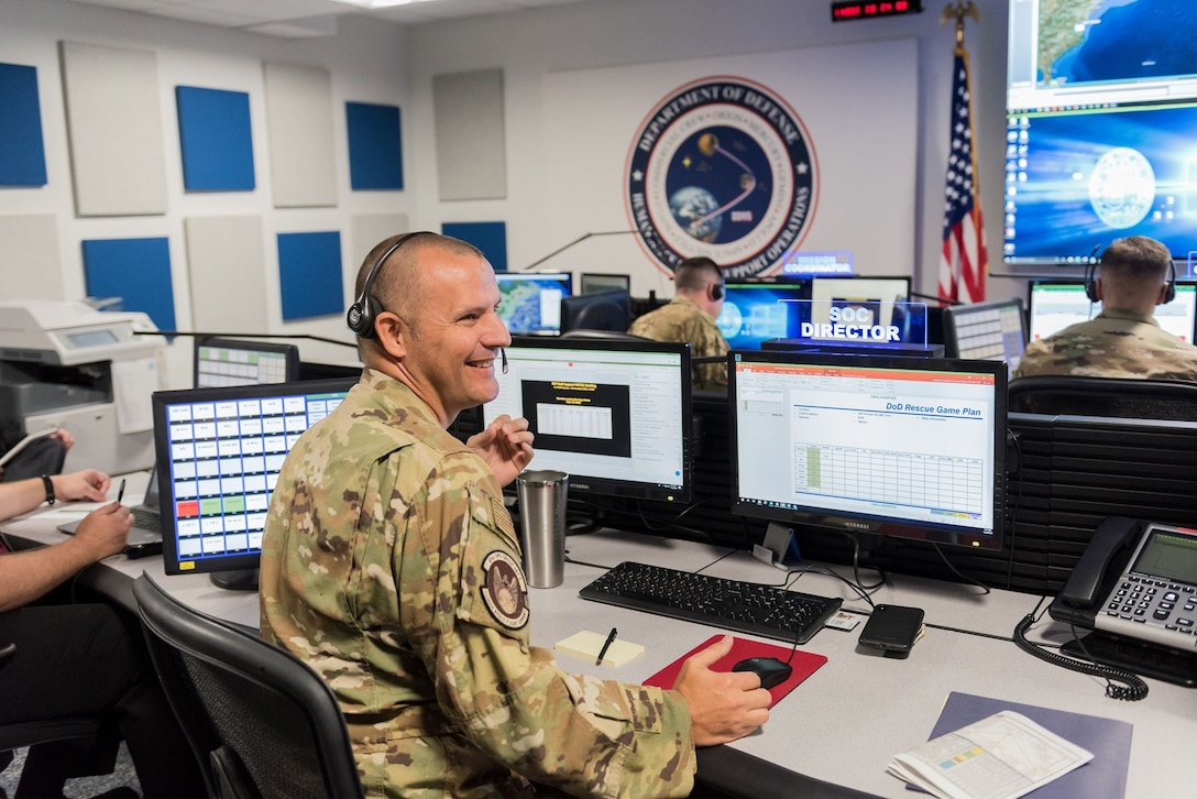 Lt. Col. Martin Crawford, 45th Operations Group Detachment 3 operation officer, directs the Det 3 team during an exercise on Nov. 20, 2019, in the Support Operations Center at Patrick Air Force Base, Fla. Det 3 is the only unit within the Department of Defense tasked to support contingency operations during Commercial Crew Program rocket launches, and is preparing for the planned return of human spaceflight within the next few months. (U.S. Air Force photo by Joshua Conti)