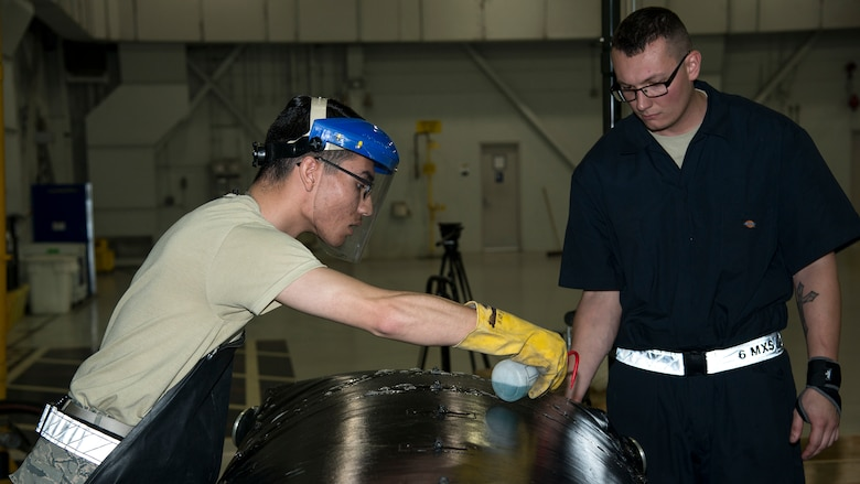U.S. Air Force Airman 1st Class Luis Garcia-Munoz, a 6th Maintenance Squadron (MXS) fuels system apprentice, and Staff Sgt. Dakota Williamson, a 6th MXS fuels system craftsman, test a fuel cell bladder for leaks at MacDill Air Force Base, Fla., Nov. 25, 2019.