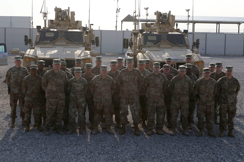 Soldiers from the Syrian Logistics Cell, 103rd Expeditionary Sustainment Command, pose for a group photo Erbil, Iraq, Dec. 1, 2019.