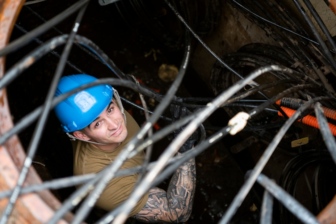 U.S. Air Force Airman 1st Class Trent Olson, 85th Engineering Installation Squadron cable antenna maintenance technician, sorts underground cabling at Tyndall Air Force Base, Florida, Dec. 9, 2019. Olson is part of a team working with the 325th Communications Squadron to relocate a node from a building that was damaged by Hurricane Michael. (U.S. Air Force photo by Tech. Sgt. Clayton Lenhardt)