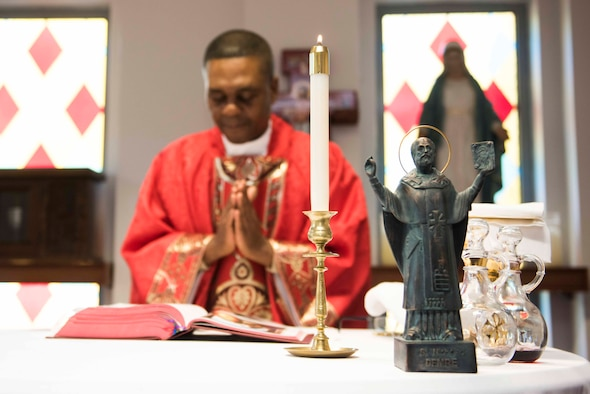 U.S. Air Force Maj. Paul Amaliri, 39th Air Base Wing deputy wing chaplain, celebrates a Catholic service in honor of St. Nicholas, whose statue stands on the altar Dec. 6, 2019, at Incirlik Air Base, Turkey. St. Nicholas served as a Christian bishop within the borders of modern-day Turkey and is the historical inspiration for the mythical Christmas figure, Santa Claus. (U.S. Air Force photo by Staff Sgt. Joshua Magbanua)