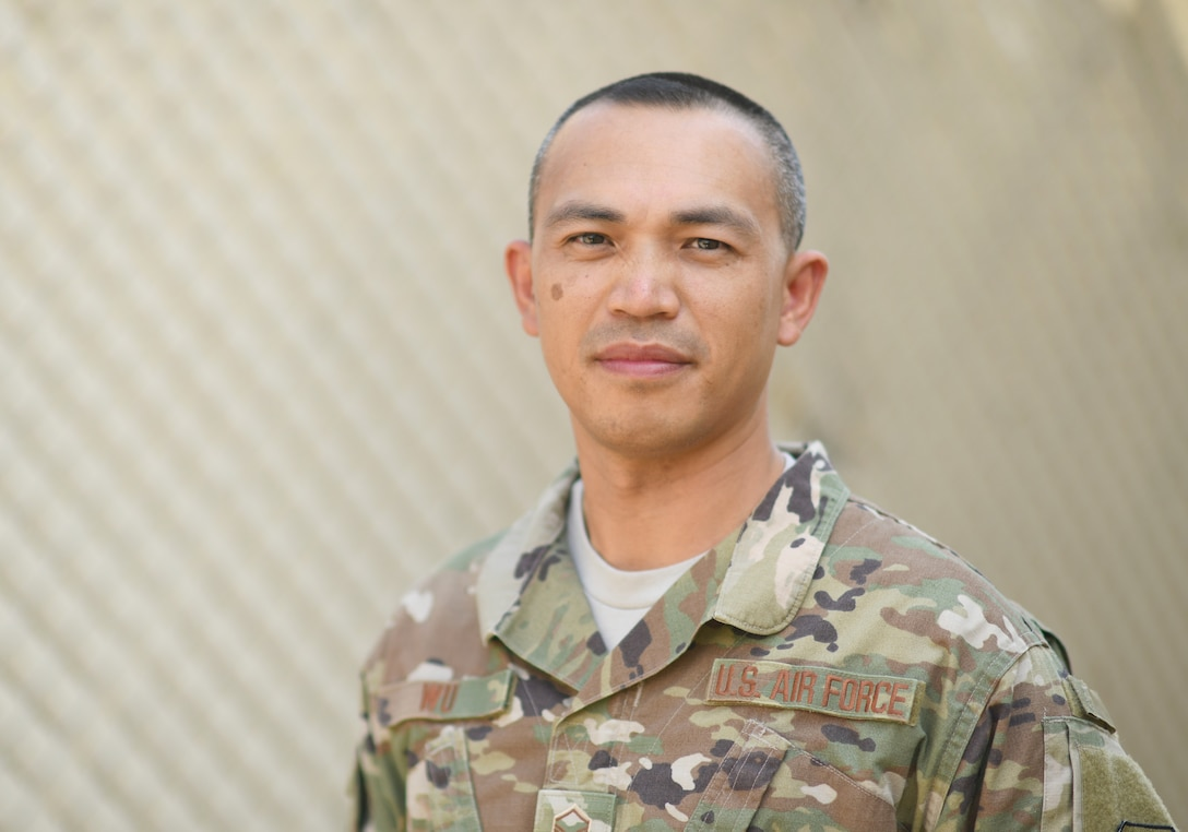 U.S. Air Force Master Sgt. Corey Wu, 726th Expeditionary Air Base Squadron disbursing agent, poses for a photo at Camp Lemonnier, Djibouti, Nov. 15, 2019. Last fiscal year, the 726th EABS Finance and Contracting Airmen executed more than $22 million, sustaining and building missions at three locations across East Africa. (U.S. Air Force photo by Staff Sgt. Alex Fox Echols III)