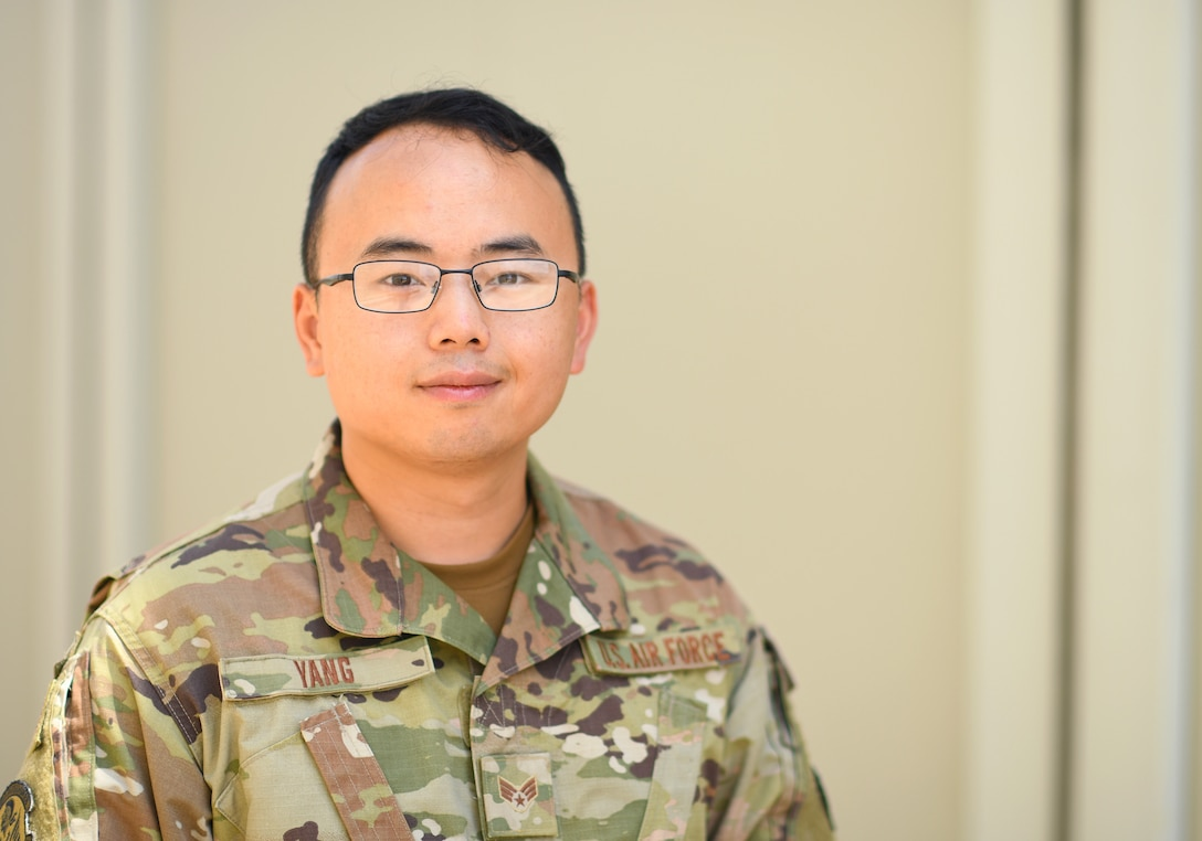 U.S. Air Force Senior Airman Blia Yang, 726th Expeditionary Air Base Squadron contracting officer, poses for a photo at Camp Lemonnier, Djibouti, Nov. 15, 2019. Last fiscal year, the 726th EABS Finance and Contracting Airmen executed more than $22 million, sustaining and building missions at three locations across East Africa. (U.S. Air Force photo by Staff Sgt. Alex Fox Echols III)