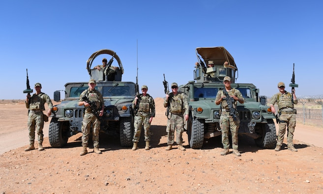The 409th Expeditionary Security Forces Squadron's Raptor 1 and 2 pose for a photo during their perimeter patrol at Nigerien Air Base 201 in Agadez, Niger, Dec. 9, 2019. The 409th ESFS vigilantly defend the base and its assets through constant patrols, vehicle inspections and the vetting of all personnel working on the installation. (U.S. Air Force photo by Staff Sgt. Alex Fox Echols III)