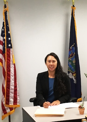 """Senior Airman Ivory Lai, 459th Security Forces Squadron, poses for a photo at her civilian job where she serves as an administrative law judge for the state of New York. Though she has a successful law career, Lai made the decision to enlist in the Air Force Reserve to become a security a security forces member and """"get the military experience"""". (U.S. Air Force photo/Staff Sgt. Cierra Presentado)"""