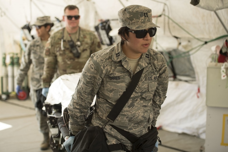 U.S. Air Force Capt. Gabriela Torres, a trauma nurse assigned to the 149th Fighter Wing's Medical Det-1, simulates providing medical treatment to to a role player during the Texas National Guard's 6th CERFP Task Force, which includes the 149th Fatality Search and Recovery Team, participated in a response evaluation exercise Dec. 7, 2019, in Round Rock, Texas. The 6th CERFP is made up of Texas Air and Army National Guard members who may be called upon to assist first responders within FEMA region 6. These regions include Texas, Arkansas, Louisiana, Oklahoma and New Mexico. (U.S. Air National Guard photo by  Tech. Sgt. Agustin Salazar)