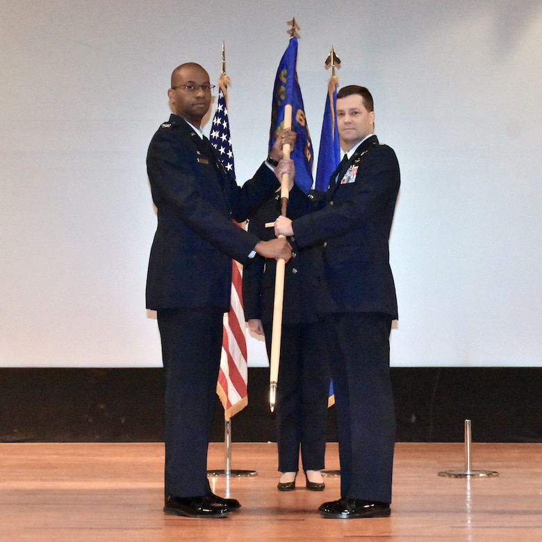 Lt. Col. Steven C. Rotz, right, accepts command of the 655 Intelligence, Surveillance, and Reconnaissance Wing, 64th Intelligence Squadron, from the 655th ISR Group commander, Col. Ricardo T. Baker, during a ceremony at Wright-Patterson Air Force Base, Ohio, Dec. 8, 2019.  Colonel Rotz joined the Air Force in 1988 as an aerospace medicine technician and commissioned as an officer in 2002. (Photo by Maj. John T. Stamm 655 ISR Wing Public Affairs)