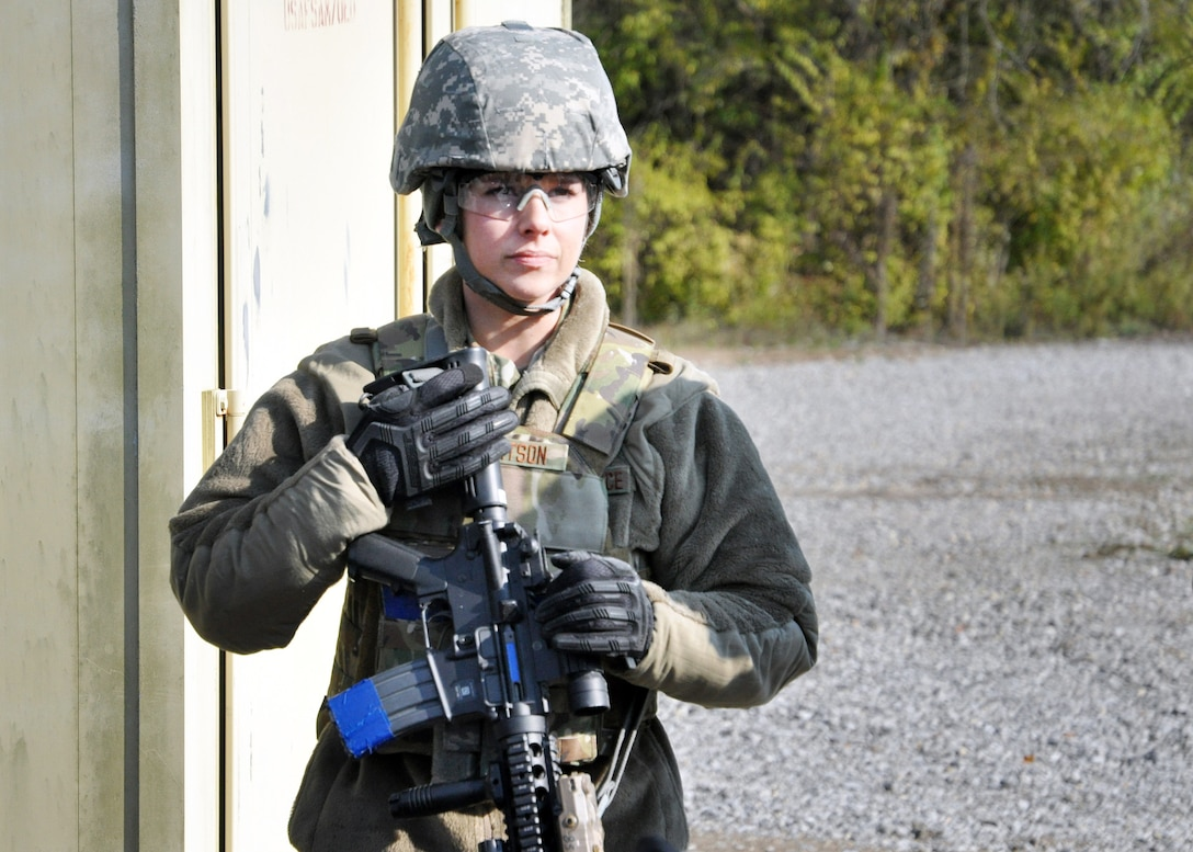 Staff Sgt. Brittany Robertson, 178th Security Forces Squadron, Springfield Air National Guard Base, Ohio, watches intently for a hand signal from her teammates during shoot, move, communicate training at the Warfighter Training Center on Wright-Patterson Air Force Base, Ohio.