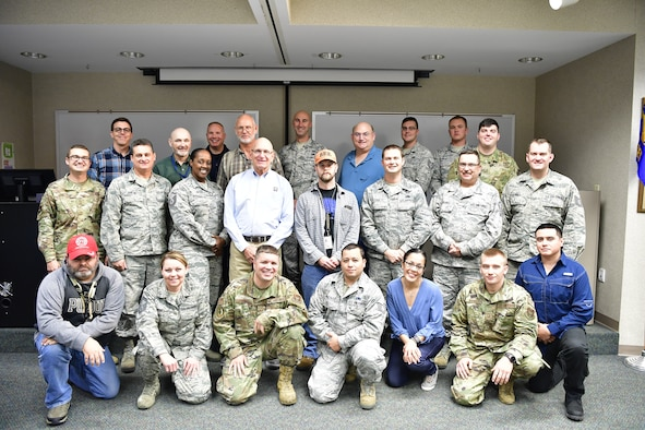 Personnel from the 434th Air Refueling Wing pose for a photo during a life safety code essential course at Grissom Air Reserve Base, Indiana, Nov. 7, 2019. The course, developed and taught by the National Fire Protection Association was designed to teach life safety code strategies. (U.S. Air Force photo/Master Sgt. Ben Mota)