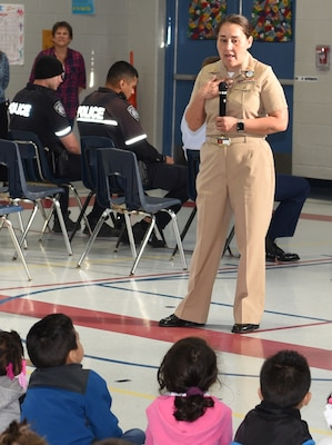 Chief Petty Officer Rosemarie Hagadus, assigned to Navy Recruiting District San Antonio, speaks with students of Dorie Miller Elementary during the school's annual Pearl Harbor and Dorie Miller Remembrance Program.  The event was held in remembrance of those who fought and for those who lost their lives Dec. 7, 1941.