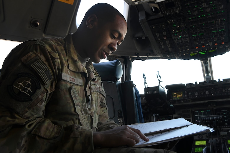Capt. Nicholas Cox, a pilot instructor, assigned to the 16th Airlift Squadron at Joint Base Charleston, S.C., conducts pre-flight checks at Pope Army Airfield N.C., December 7, 2019. The 16th AS staged at Pope to load the 82nd Airborne assigned to Fort Bragg, N.C.. The 437th Airlift Wing supported Joint Forcible Entry 19B by sending a three-ship to the Nevada Testing and Training Range to conduct personnel airdrop operations with the 82nd Airborne, three other C-17 Globemaster III's, and 17 C-130J Hercules. (Photo by Staff Sergeant Lance Valencia)