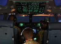 Capt. Nicholas Cox, a pilot instructor, and Capt. Jacob Nations, copilot assigned to the 16th Airlift Squadron at Joint Base Charleston, S.C., conducted pre-flight checks at Pope Army Airfield N.C., December 7, 2019. The 16th AS staged at Pope to load the 82nd Airborne assigned to Fort Bragg, N.C.. The 437th Airlift Wing supported Joint Forcible Entry 19B by sending the a three-ship to the Nevada Testing and Training Range to conduct personnel airdrop operations with the 82nd Airborne, three other C-17 Globemaster III's, and 17 C-130J Hercules. (Photo by Staff Sergeant Lance Valencia)