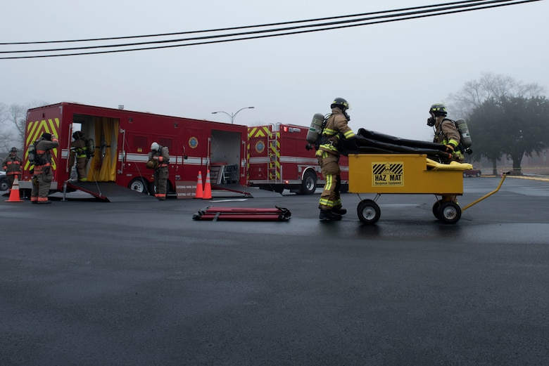 Members of the 4th Civil Engineer Squadron fire department and the Goldsboro Fire Department, set-up a decontamination station during a Hazardous Material Spill Response exercise, Dec. 9, 2019, in Goldsboro, N.C.