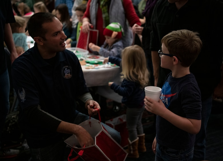 A little boy receives a gift