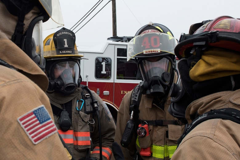 Members of the 4th Civil Engineer Squadron and the Goldsboro Fire Department, receive a brief prior to conducting decontamination procedures during a Hazardous Material Spill Response exercise, Dec. 9, 2019, in Goldsboro, N.C.